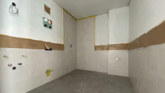 Das Badezimmer noch ohne Sanitäreinrichtung