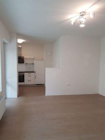 Wohnzimmer Blick in die Küche Whg. 0.02