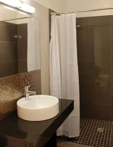 One-Room-Apartment Design Sleep Badezimmer