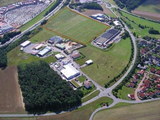 Luftbild auf Grundstücke/Wertheim Village