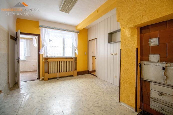 Zimmer im EG mit zusätzlicher Ofenfeuerstelle