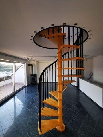 Wendeltreppe zum oberen Wohnbereich